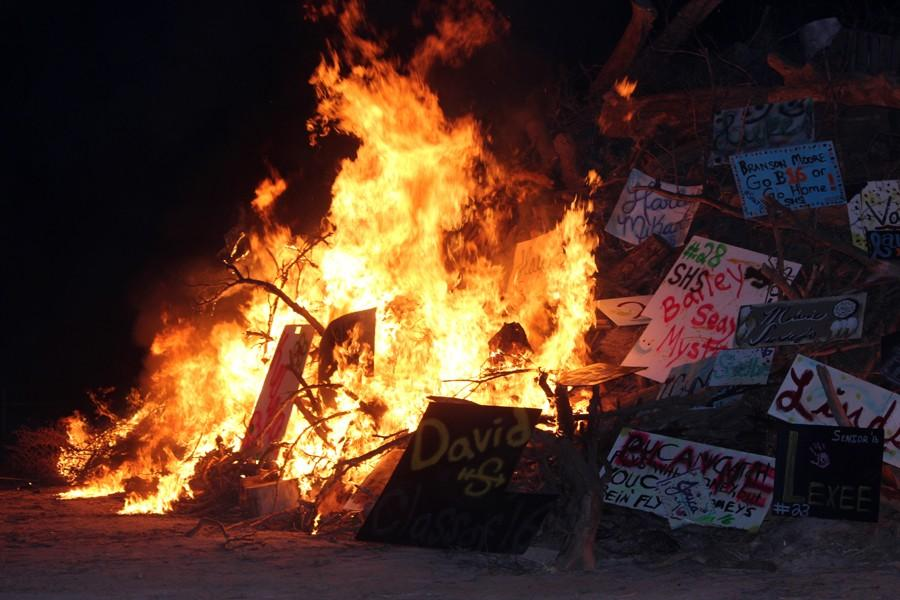 Up+in+flames--Senior+signs+succumb+to+the+flames+as+the+bonfire+is+lit+at+Gaines+County+Park+on+Sept.+10.