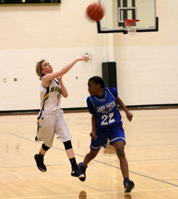 Heave it-- Freshman Avery Logan throws the ball down court during the 35-26 win over Estacado on Jan. 24.