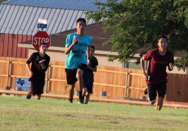 Getting in shape-- Senior Antonio Arreola Lechuga and brother junior Luis Arreola lead the pack of runners during summer workouts in August.