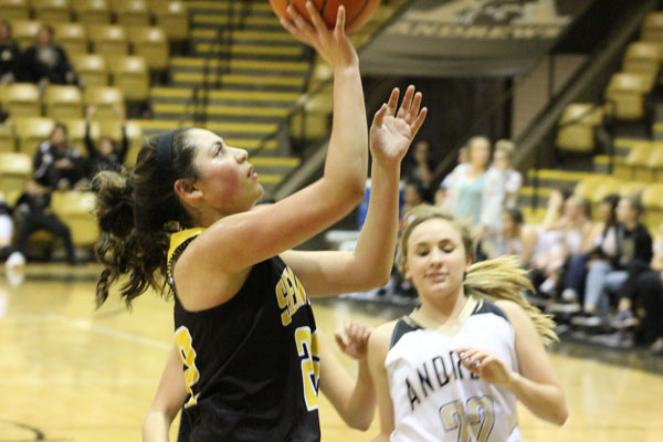 Freshman phenom-- Freshman forward Bretlei Dominguez goes in for a layup during preseason play with Andrews on Nov. 14. Dominguez had 15 points in the 90-38 Maiden win.
