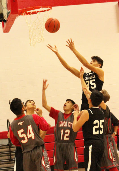 Elevate--Freshman post Edgar Castro goes for the rebound during district play with Denver City. The Indian win moved their district record to  4-2.