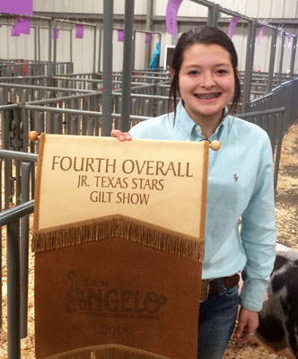 Wooly winner--Junior High FFA member Briana Foote brings home the champion Poland China gilt banner from the San Angelo Stock Show.