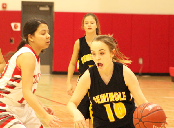 Moving the ball--Freshman guard Jessie Beaubien dribbles past a Denver City defender during district play on Jan. 30. The Maiden loss to the Fillies moved their district record to 4-4.