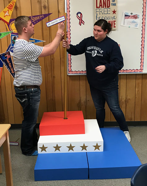 Putting it together--SkillsUSA senior Cade Thomas and sophomore Destiny Conejo put together their chapter display for competition during practice on Feb. 21. The display took the district championship on Feb. 24, qualifying the team for state competition.