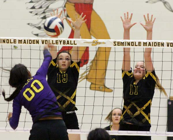 Block party-- Sophomore outside hitter Kasey Long and freshman middle blocker Zoee Nolen put up defense against Pecos in Tuesday's Maiden win.