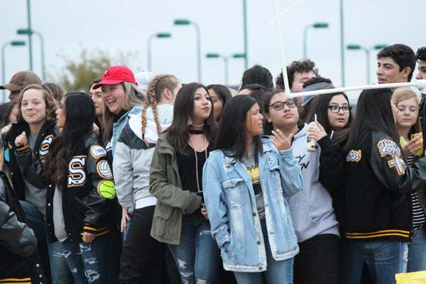 Floating along-- Seniors crowd onto their homecoming float during the parade on Oct. 11.