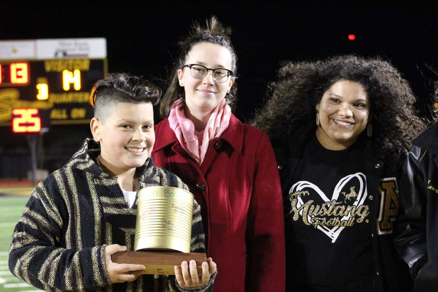 Canning Andrews-- Student council freshman representative and junior Treasurer Aubrey Hewitt accept the trophy from Andrews representatives during halftime of the last district game on Nov. 9