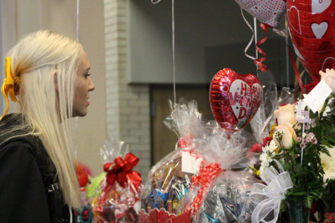 Looking for love-- Sophomore Emma Franklin searches the accumulation of Valentine