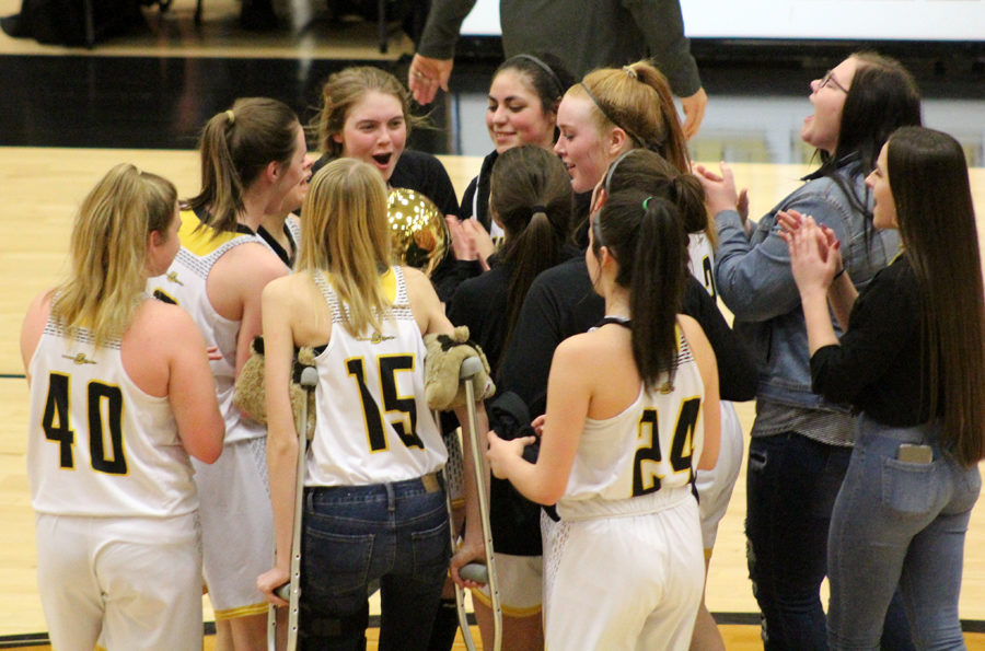 Gold+ball--%0AThe+Maidens+celebrate+midcourt+after+receiving+the+district+championship+trophy+after+defeating+Andrews%2C+83-35%2C+in+the+final+district+game+on+Feb.+5.+The+Maidens+went+undefeated+for+the+title.