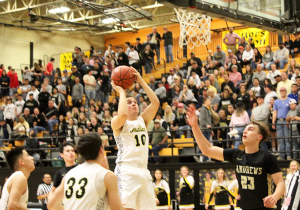Lane scoring-- Senior guard Jordan Matthews pulls up for a jumper in the lane during fourth quarter play against Andrews on Feb. 5. The Indians moved to 6-0 in district with the 43-33 win.
