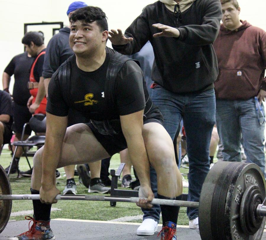 Breaking records-- Senior Ian Alvidrez lifts 1,560 pounds at the Seminole meet on Jan. 24. Alvidrez has broken the region record twice since January.