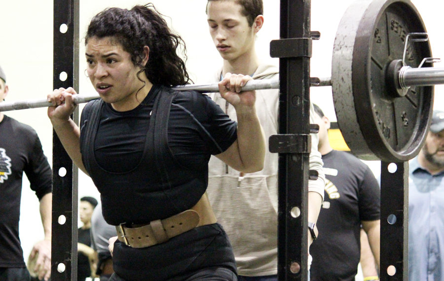 Statebound--%0AJunior+Siria+Martinez+competes+in+the+squat+at+the+Seminole+meet+on+Jan.+24.+Martinez+took+first+place+in+the+region+on+March+2%2C+qualifying+for+state+competition+next+week.