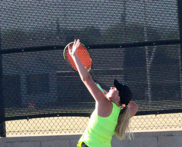 Three doubles teams advance to regional tennis