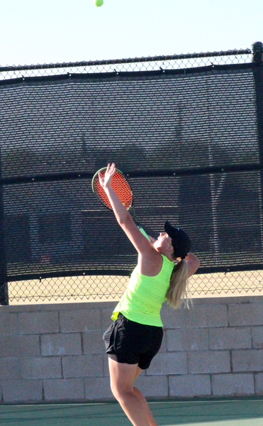 Serving for regionals-- Junior Julie Enns serves during the district tie breaker in mixed doubles on April 10. Enns and partner sophomore David Wiebe defeated  a Monahans team to get second and advance to region.