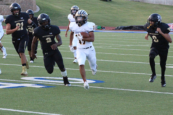 LEADING THE CHASE--Junior running back Damion Espino takes the ball downfield during the season opener in Lubbock on Aug. 29. Espino scored the first touchdown of the 57-7 win over the Westerners.