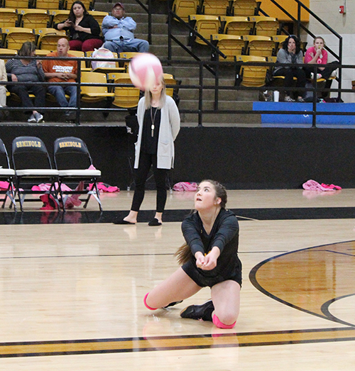 ON THE FLOOR-- Sophomore libero Emily Alvarez falls to her knees in serve receive on Oct. 22 in a non-district match versus Denver City. The Maidens fell in three sets to the Fillies.