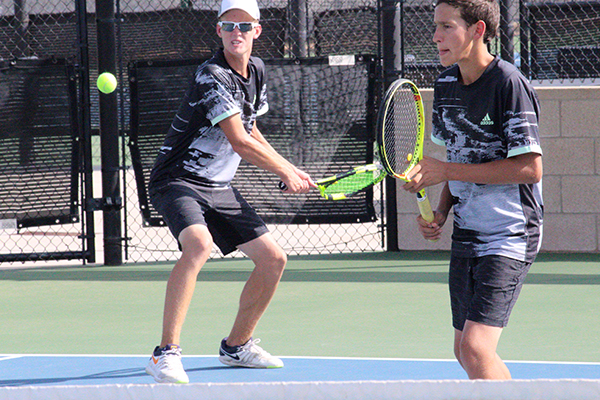 I%27VE+GOT+IT--Senior+Alex+Froese+takes+aim+as+he+and+partner+junior+Justin+Giesbrecht+defeat+Andrews%27s+Chris+Curry+and+Julio+Cortez+in+men%27s+doubles+during+district+play+on+Oct.+1.