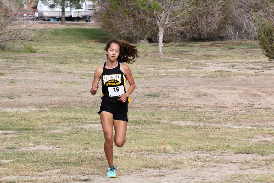 REGIONAL+BOUND--%0AJunior+Hailey+Davis+runs+at+the+Pecos+golf+course+during+district+competition+on+Oct.+14.+Davis+took+fifth+as+the+top+Maiden+runner.