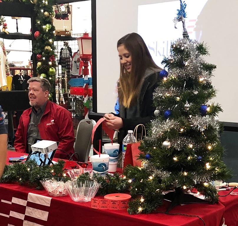 Making mistletoe money-- Auto tech sponsor Thomas Spence and SkillsUSA sophomore Sarah Teichroeb work the SkillsUSA booth at the Mistletoe Market on Nov. 15. The group broke fund-raising records with over $4,200.
