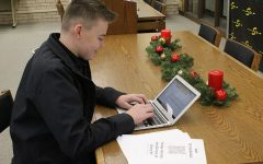 Making plans-- Sophomore Ervin Friesen works on the business plan for On The Go Auto on Dec. 10. Friesen and sophomore Davis Banman submitted the entrepeneur plan to Red Raider Start Up's contest.