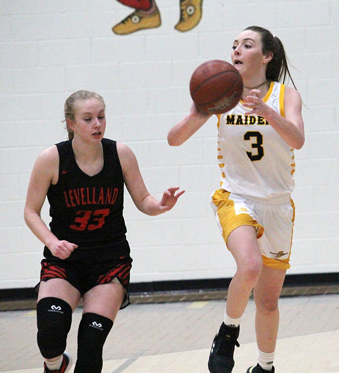 Historic win-- Junior post Macey Duncan makes an outlet pass on the break during preseason play against Levelland on Dec. 17. Duncan had 15 points in the Maidens first win over the Loboettes in the junior's career.