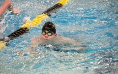 Number five-- Senior Andy Proffer warms up for the home swim meet in December. Proffer broke the school breastroke record for the fifth time during district prelims on Jan. 17 in Andrews.