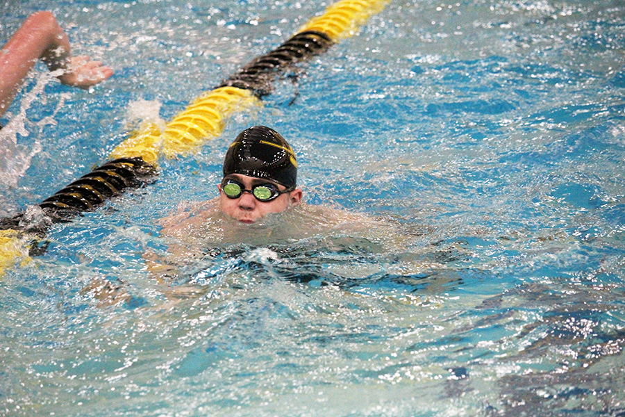 Number+five--%0ASenior+Andy+Proffer+warms+up+for+the+home+swim+meet+in+December.+Proffer+broke+the+school+breastroke+record+for+the+fifth+time+during+district+prelims+on+Jan.+17+in+Andrews.