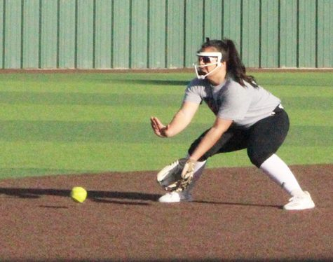 Scooping it up-- Glove extended, junior pitcher Alyssa Olivas fields a ball during practice on Feb. 10 during after school practice.