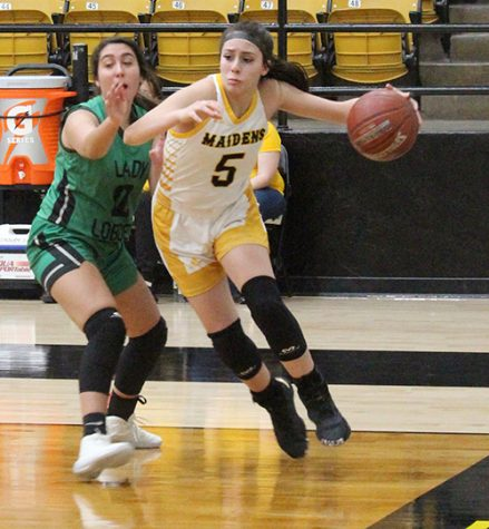 District MVP-- Sophomore guard Xoe Rosalez drives the baseline during district play hosting Monahans on Jan. 28. Rosalez was selected as District 2-4A