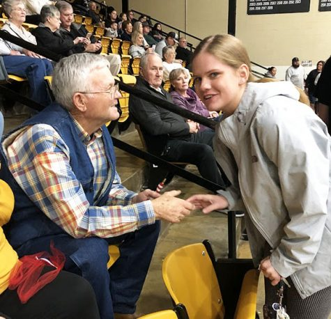 Thanking their service--SkillsUSA Culinary senior Katy Beth Lashaway shows veteran Darrell Johnson to his seat at a home basketball game. The SkillsUSA chapter honored five veterans during January and February home games.