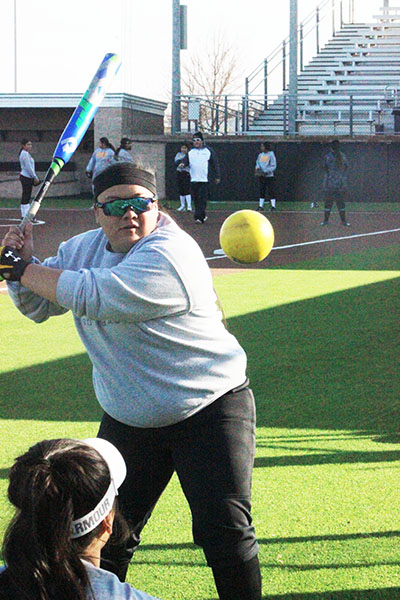 "Power hits-- Senior third base Alicia ""Thunder"" Rosalez practices her hitting during Maiden work outs on Feb. 10."