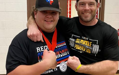 State qualifier-- Senior Kwinton Jennings and Coach Call Barnard celebrate after Jennings qualified for state on March 13. He lifted a total of 1,600 pounds