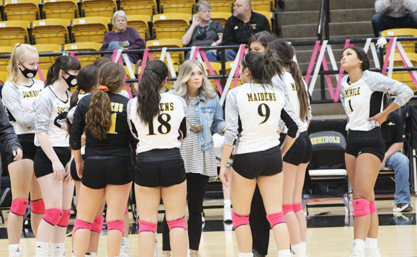 Talking about it Maiden Coach Haley Ross calls a time out during the fifth set of the Greenwood game on Oct. 24. The Maidens would fall to the Rangerettes, but defeat Pecos in a seeding game on Oct. 26 for fourth place.