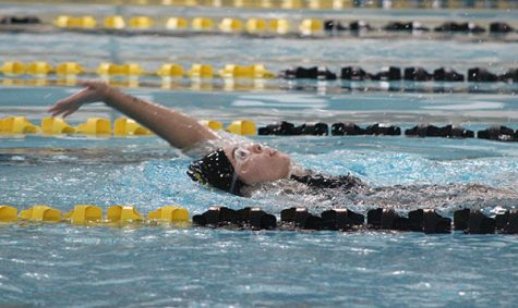 For the win-- Junior Ana Nevarez Castillo takes first in the 100-meter backstroke during the home meet on Dec. 12. Nevarez Castillo swam the race in 1:32.09.