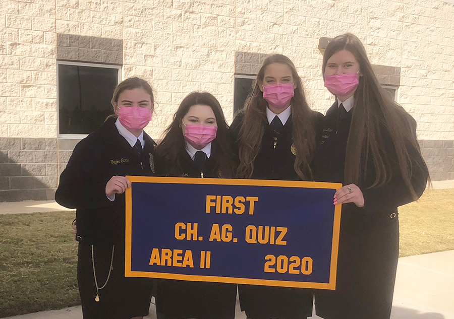 Area+champs--%0AThe+FFA+senior+quiz+team+shows+off+its+Area+II+first+place+banner+that+earned+a+berth+in+state+competiton.%0AThe+team+of+seniors+Taylor+Carter%2C+Payton+Carter%2C+junior+Zoee+Nolen+and+senior+Delaney+Brown+took+third+at+state+on+Dec.+4.
