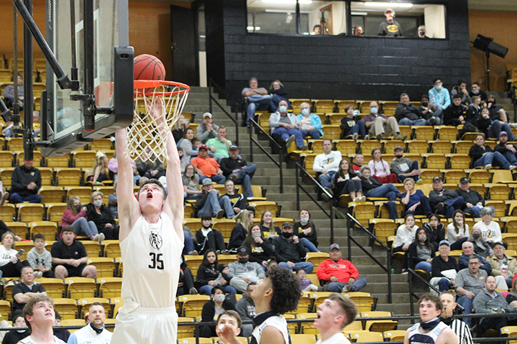 Putting it down-- Senior forward Blake Hamblin dunks the ball during the 76-45 win over Greenwood on Feb. 5. Hamblin had 11 points and 12 rebounds in the game.