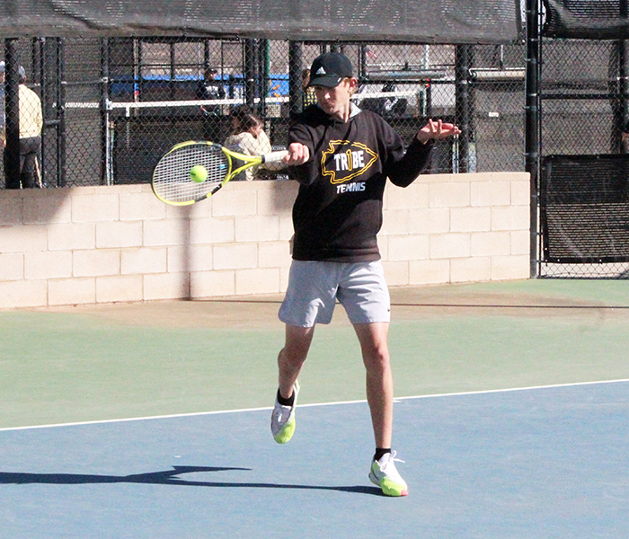 Returning fire--Senior Daniel Fehr volleys during doubles play at the Seminole quad match on Feb. 26.