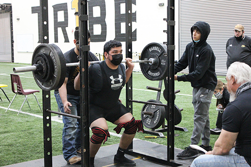 Clean lift-- Sophomore Jeremias Talamantes squats 420 pounds during the first event of the Seminole meet on Jan. 28. Talamantes would take first in the 220-pound division with a total weight of 1,030 pounds.