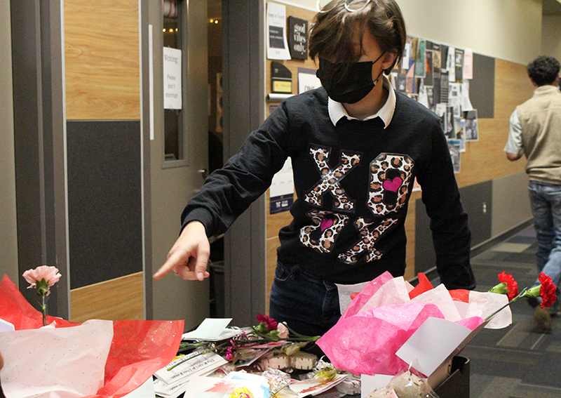Making deliveries-- StuCo freshman Madison Fieler delivers Valentine o Grams to fourth period classes on Feb. 12. Price packages ranged from $1 to $10.