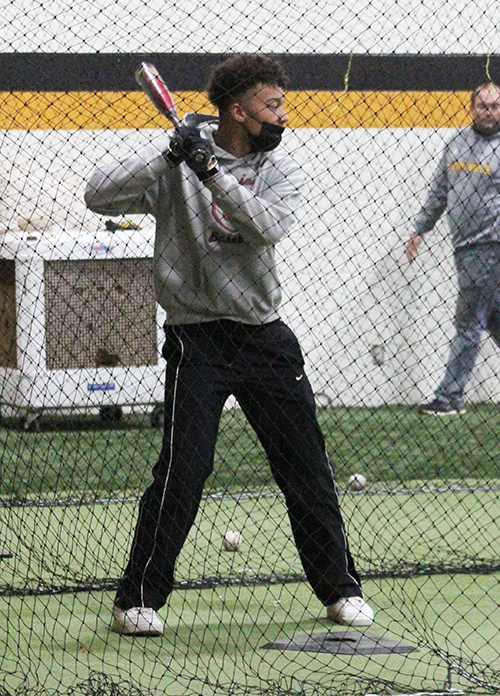 Eye on the ball-- Senior short stop Preston Stevenson works on his hitting during fifth period athletics on Feb. 10. The Indians will play the first regular season game on Feb. 22.