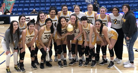 Going to region tournament-- Maidens celebrate with the quarterfinal trophy after defeating Hereford, 61-53, on Feb. 19 in the Rip Griffin Center at Lubbock Christian University.