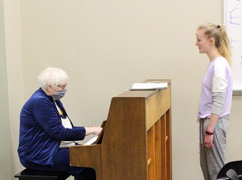 "Working toward state-- Accompaniest Jean Moffatt plays as senior soprano Amber Wilkey works on her solo ""Non posso dis perar"" for UIL solo and ensemble competition during eighth period A Cappella on Jan. 13. Wilkey qualified for state in both solo and ensemble on Feb. 5."
