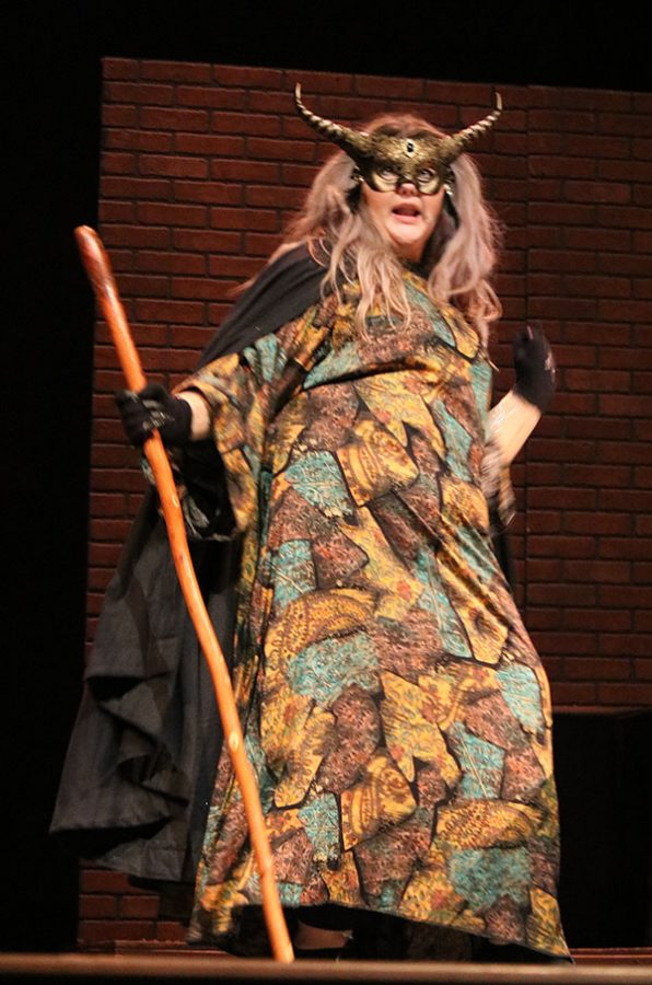 Villainous ways--Senior Reese Cooper embraces her evil during the Nov. 19 production of Into the Woods.