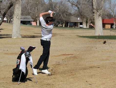 Letting it fly-- Junior Cason Johnson drives for the green during morning play at Andrews on March 6. Johnson took fourth individually while the team took second overall.