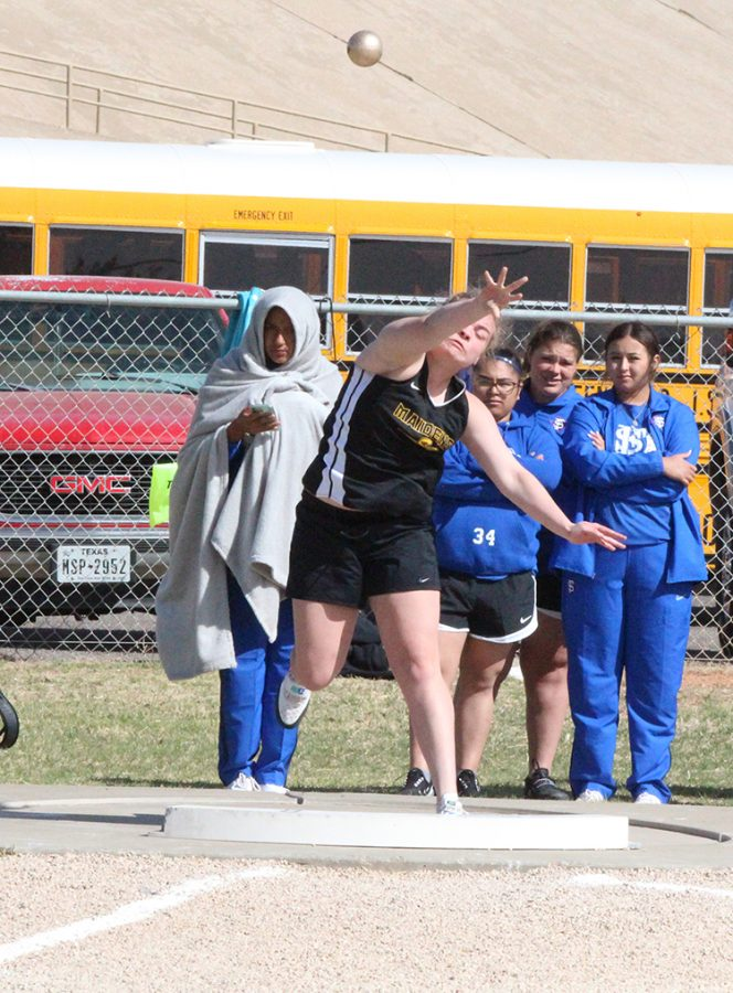 Qualifying throw--Senior Taylor Carter competes in the shot put at district in Andrews on March 31. Carter threw 33 feet, 9 and 1/4 inches to take third and qualify for area.
