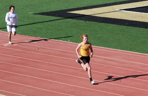 Fast freshman-- Freshman Landry Reames runs the anchor leg of the 800-meter relay at the district meet in Andrews on April 1.  Reames and sophomore Blake Flowers stepped in to help the team qualified for area after two of the senior sprinters were injured.