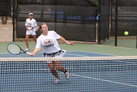 Net ball--Senior Lauren Smith goes for the return as she and partner senior Marcela Guevara compete in district on the home courts on April 16. The pair would defeat Andrews for the championship in women