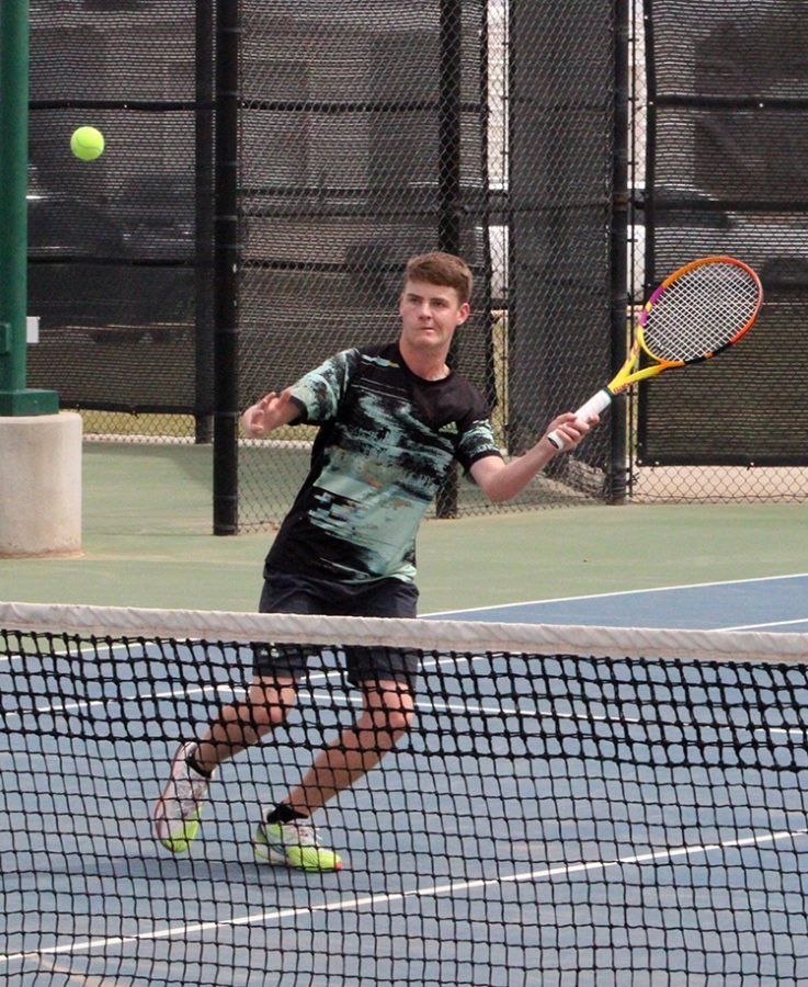Taking aim--Sophomore Ruger Scott keeps his eye on the ball during district play on April 16. Scott and partner senior James Giesbrecht took second in mens doubles to advance to regionals.