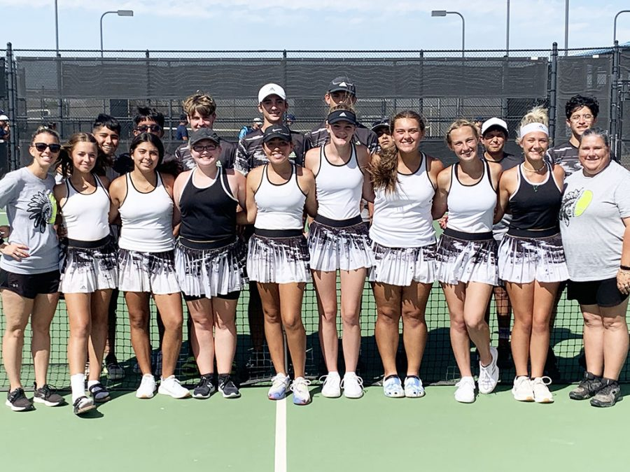 Bi-district champs--Tribe tennis defeated Greenwood, 10-9, for the championship on Oct. 12 in Odessa.