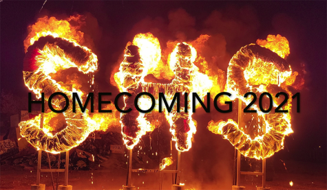 Flaming letters--Students wrapped letters in cloth to set ablaze at the homecoming bonfire on Sept. 23.
